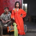 bright orange dress by khaadi