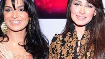 Reema and Meera were found embracing each other at Red Carpet of PFDC Sunsilk 2012.