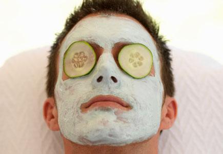 A young man having facial treatment at a health spa