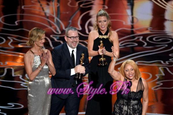 Janet Friesen, director Morgan Neville, producer Caitlin Rogers, and singer Darlene Love awarded for 20 feet from Stardom