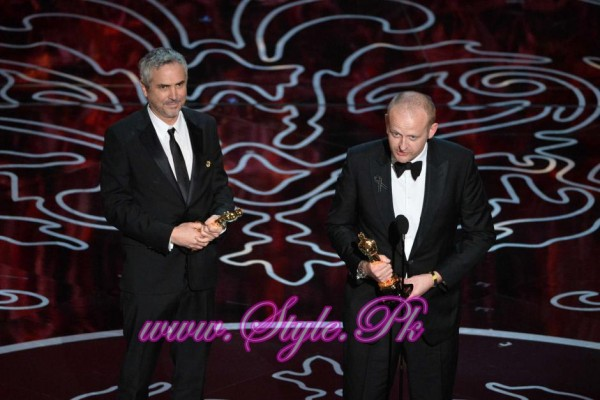 Alfonso Cuaron and Mark Sanger accept the best editing award