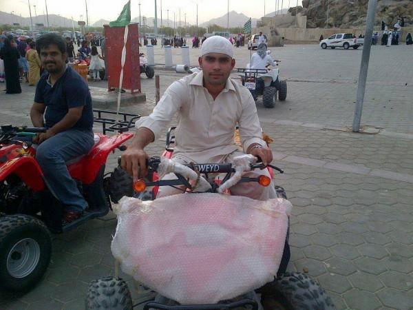 Umar Akmal Umrah Pics 08