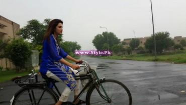 See Fiza Ali riding bicycle in Rain.
