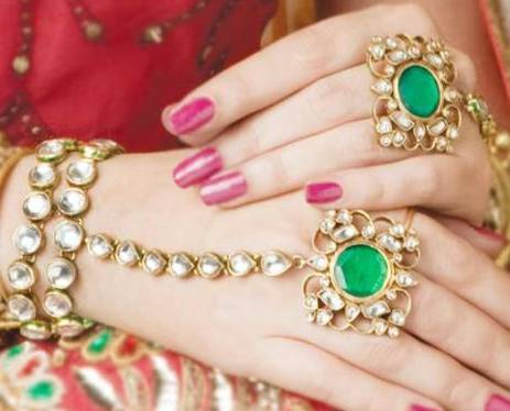 Kundan braclet with finger rings