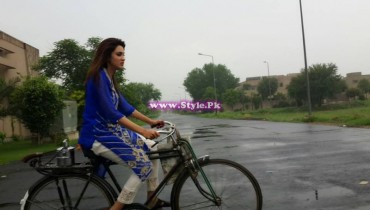 See Fiza Ali riding bicycle in Rain.