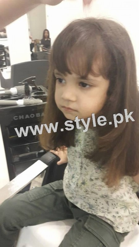 Pictures of Fahad Mustafa's daughter while having a haircut