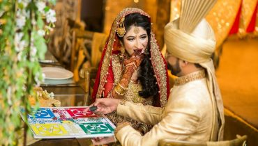 Bride And Groom Playing Ludo On Their Wedding